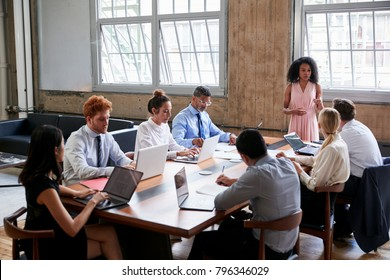 Black businesswoman addressing colleagues at a board meeting