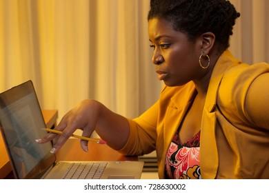 Black businesswoman working mobile