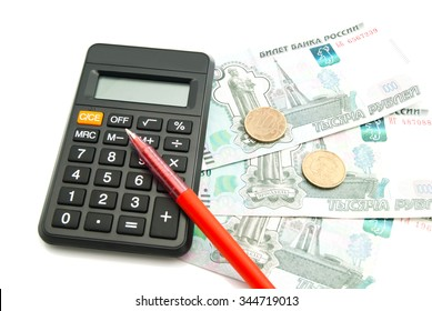 black calculator, banknotes and pen closeup on white