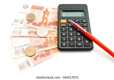 black calculator, banknotes and pen on white background closeup