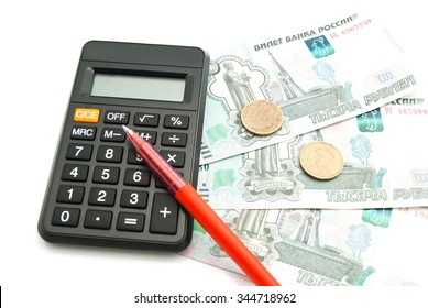 black calculator, banknotes and pen on white closeup