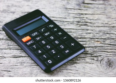 black calculator on a wooden table