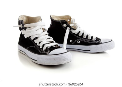 Black canvas high top sneakers or tennis shoes on a white background