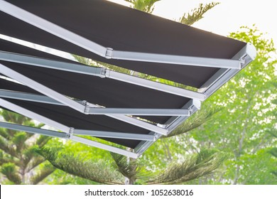black canvas with steel machanic structure awning on tree background