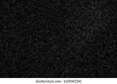 Black canvas or velvet paper texture. Closeup