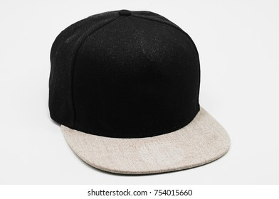 Black cap with light gray flap isolated on white. Straight flap cap with no brand.