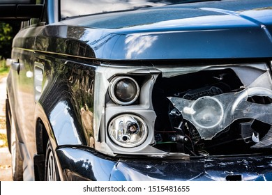 black car with damaged headlamp after accidented. Close up car crash, insurance concept. Passenger vehicle side headlight is broken