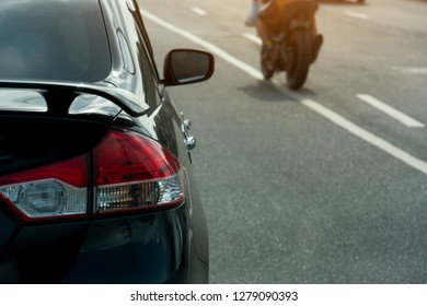 Black car drive on the asphalt road with motorbike and line white color.