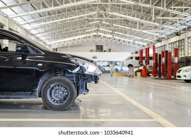 black car repair station with soft-focus and over light in the background