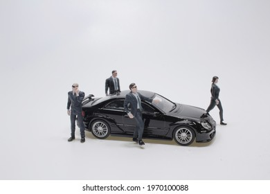 black car with the team of mini Security guard