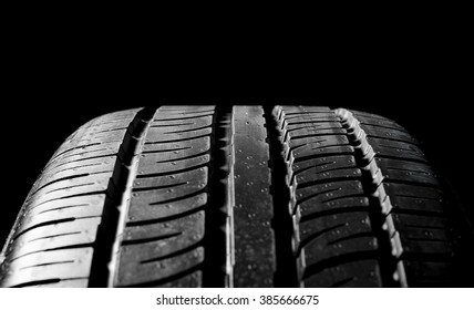 black car tire isolated on black background