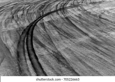 Black car tire skid mark on asphalt road track texture and background, Automobile and automotive car drift skid mark on race track.