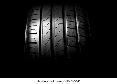 black car tyre isolated on black background
