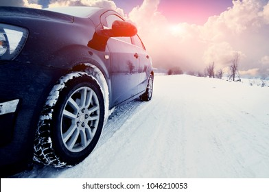 black car at winte on the snowly road