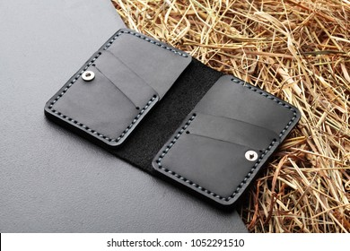Black card holder. Hand made leather man card holder. Multi colored. Leather craft.On creative background .Top view