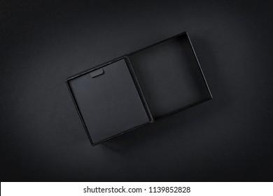Black cardboard box top view on black. Low key studio shoot