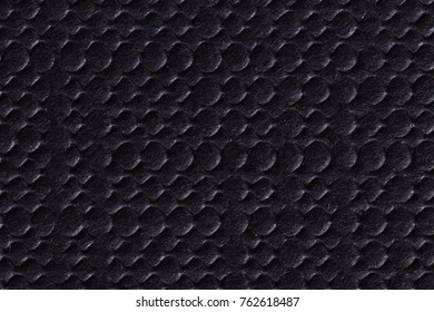 Black cardboard texture as background. High resolution photo.