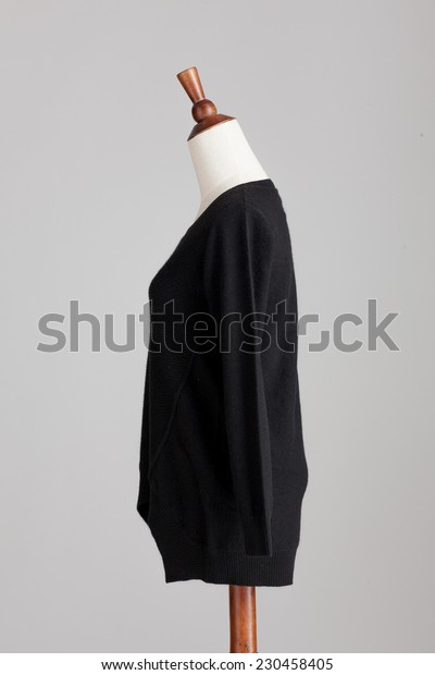 black cashmere sweater with wood model on grey isolated