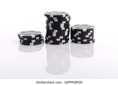 Black casino chips with shadows isolated on the white