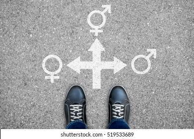 Black casual shoes standing at the crossroad making decision which way to go - man, woman or transsexual including gay, lesbian, homosexual.
