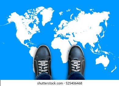 Black casual shoes standing on world map start making his journey around the world.