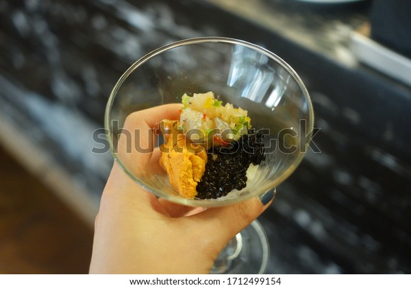 Black caviar and Uni in a glass for eating like a salad.