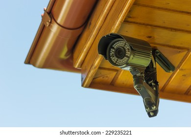 Black CCTV security camera under the roof