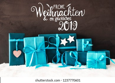 Black Cement Background With German Calligraphy Frohe Weihnachten Und Ein Glueckliches 2019 Means Merry Christmas And A Happy 2019. Turquoise Christmas Gifts Or Presents On Snow.