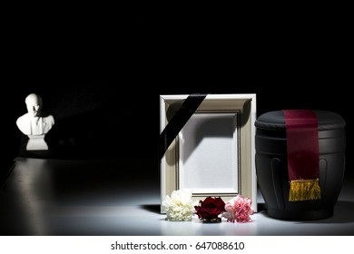 black cemetery urn with blank mourning frame and Lenin statue for Communist funeral on dtrk background