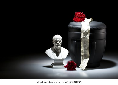 black cemetery urn with Lenin statue for Communist funeral on dark background