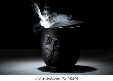 black cemetery urn for sympathy card on dark background