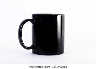 Black ceramic mug on white background