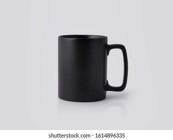 Black Ceramic mug on white background. Blank drink cup for your design.