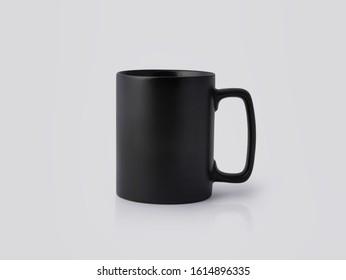 Black Ceramic mug on white background. Blank drink cup for your design.