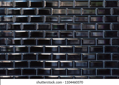 Black ceramic tile on the wall in minimalistic style