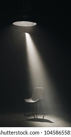 A black chair on dark background, low key and spotlight.