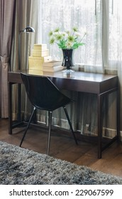 black chair with wooden table at home