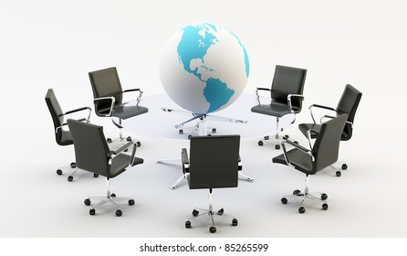 Black chairs around a light office table and a world
