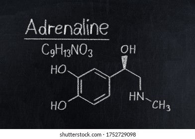 Black chalkboard with the chemical formula of Adrenaline.