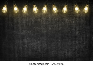 black chalkboard compose wtih open light bulb