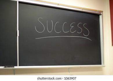 Black chalkboard with success written on it