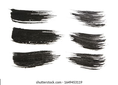 black charcoal brush stroke isolated on white background.