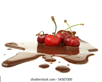 Black cherries in chocolate spill
