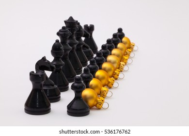 Black chess figure and golden Christmas decoration on the white background