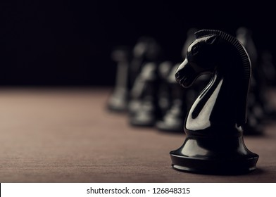 black chess knight on background