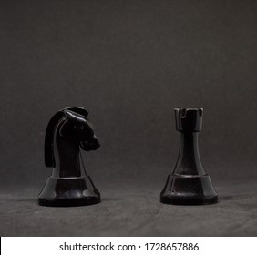 Black chess are on a black background