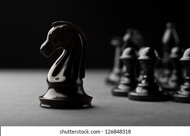 black chess pieces on background