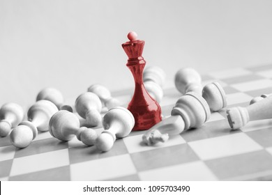 Black chess queen beats whites on chessboard over white background. Win and success concept, copy space