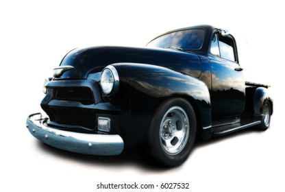 black chevy truck, with blue sky reflected in bodywork