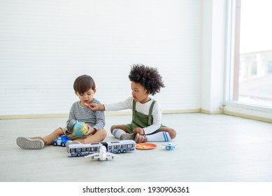 Black children and white children play with toys and have fun. Concept of apartheid And racism